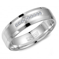 A White Cobalt Torque Band With 9 Diamonds And Sandpaper Edges.
