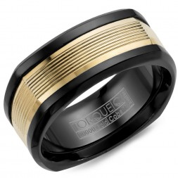 A Black Cobalt Torque Band With A Yellow Gold Inlay Featuring Carved Line Detailing.