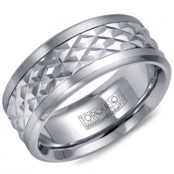 A Torque Ring In White Cobalt With A Carved Patterened White Gold Center.