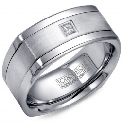 A Torque Ring In White Cobalt With A White Gold Inlay And A Princess Cut Diamond.