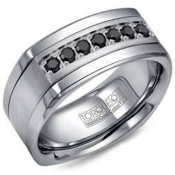 A Torque Ring In White Cobalt With A White Gold Inlay And Seven Black Sapphires.