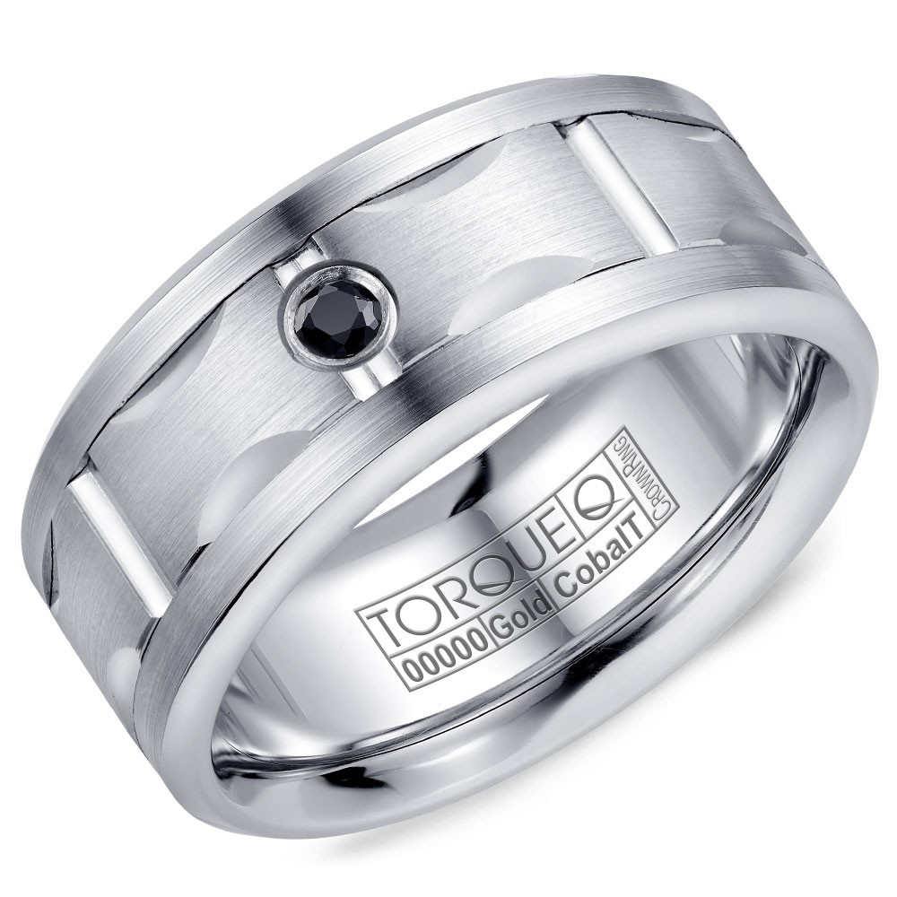 A Torque Ring In White Cobalt With A Carved White Gold Center And A Black Sapphire.