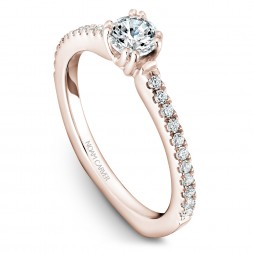 A Carver Studio rose gold engagement ring with 23 diamonds.