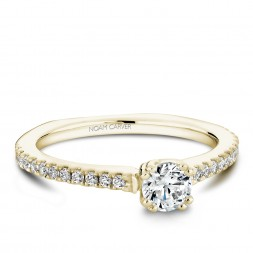 A Carver Studio yellow gold engagement ring with 23 diamonds.