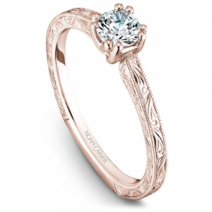 A Carver Studio engraved rose gold engagement ring with a round center stone.