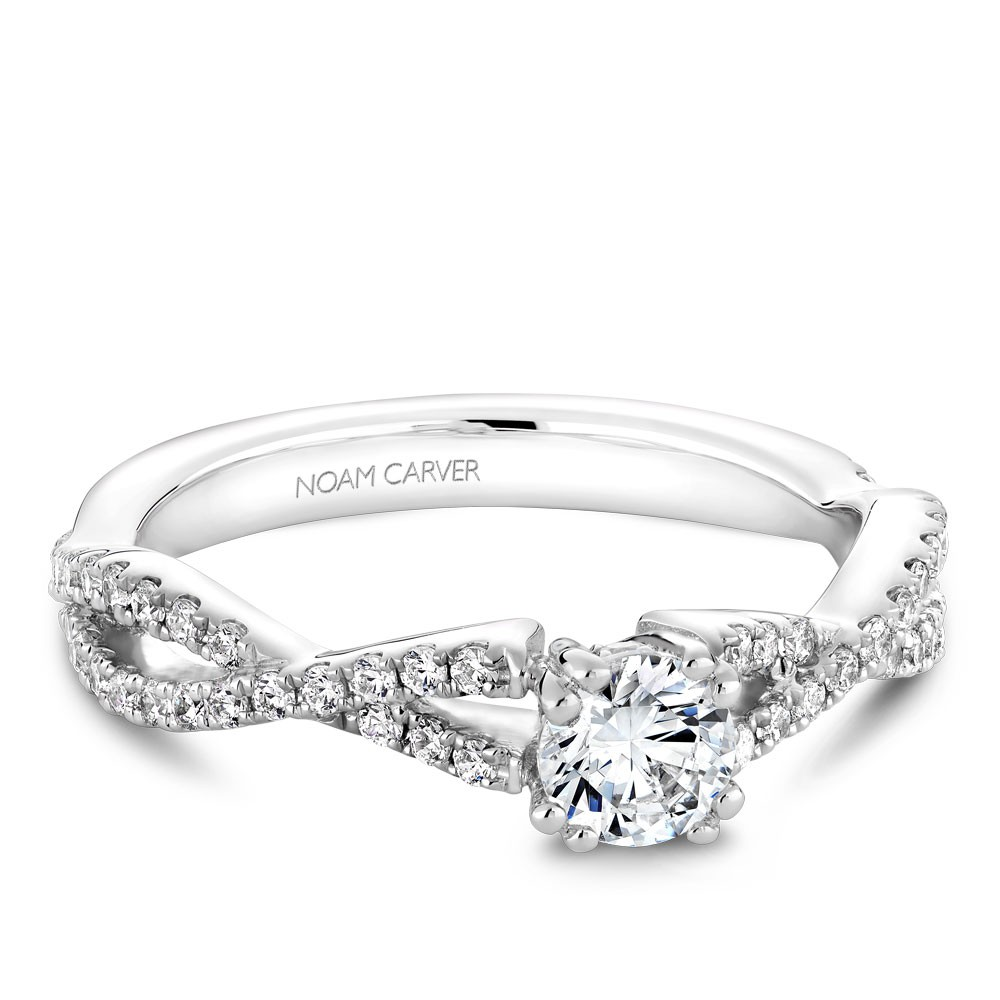 A Carver Studio white gold engagement ring with a twist band and 53 diamonds.
