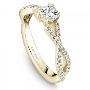 A Carver Studio yellow gold engagement ring with a twist band and 53 diamonds.