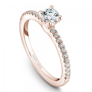 A solitaire Carver Studio rose gold engagement ring with 23 diamonds.
