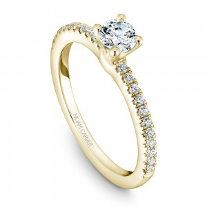 A solitaire Carver Studio yellow gold engagement ring with 23 diamonds.