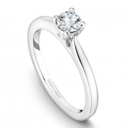 A solitaire Carver Studio white gold engagement ring with a round center stone.