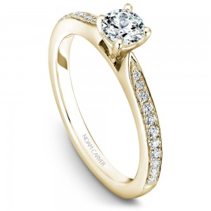 A solitaire Carver Studio yellow gold engagement ring with a round center stone and 23 diamonds.