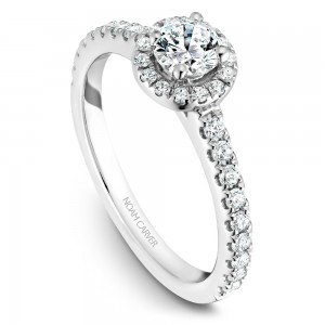 A halo Carver Studio white gold engagement ring with a round center stone.