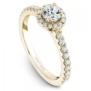 A halo Carver Studio yellow gold engagement ring with a round center stone.