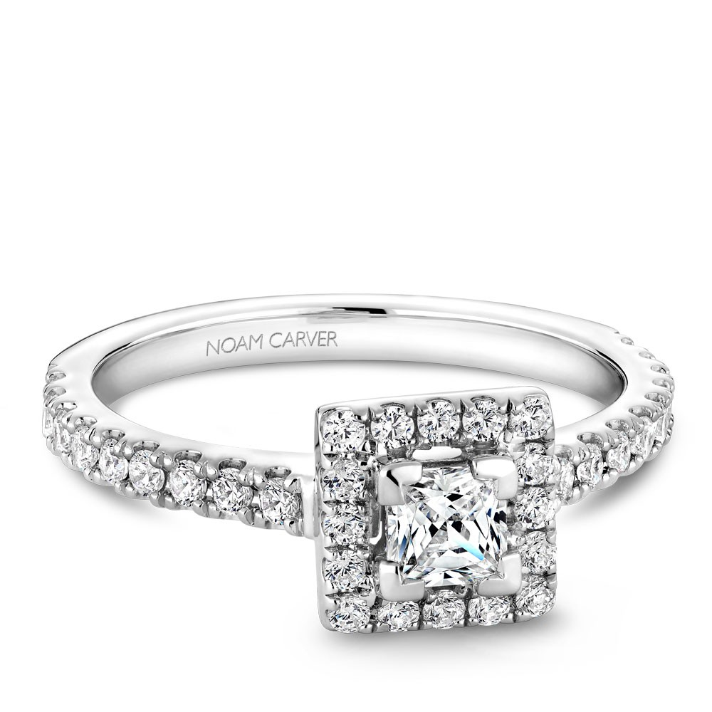 A Carver Studio white gold engagement ring with a square halo .