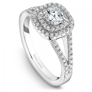 A Carver Studio white gold engagement ring with a double halo .