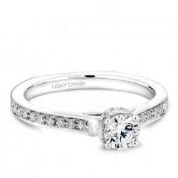 A solitaire Carver Studio white gold engagement ring with 38 diamonds.