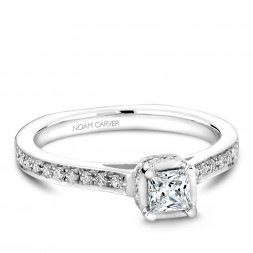 A solitaire Carver Studio white gold engagement ring with a princess diamond and 35 diamonds.