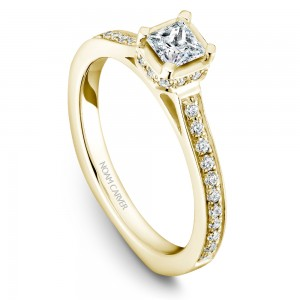 A solitaire Carver Studio yellow gold engagement ring with a princess diamond and 35 diamonds.