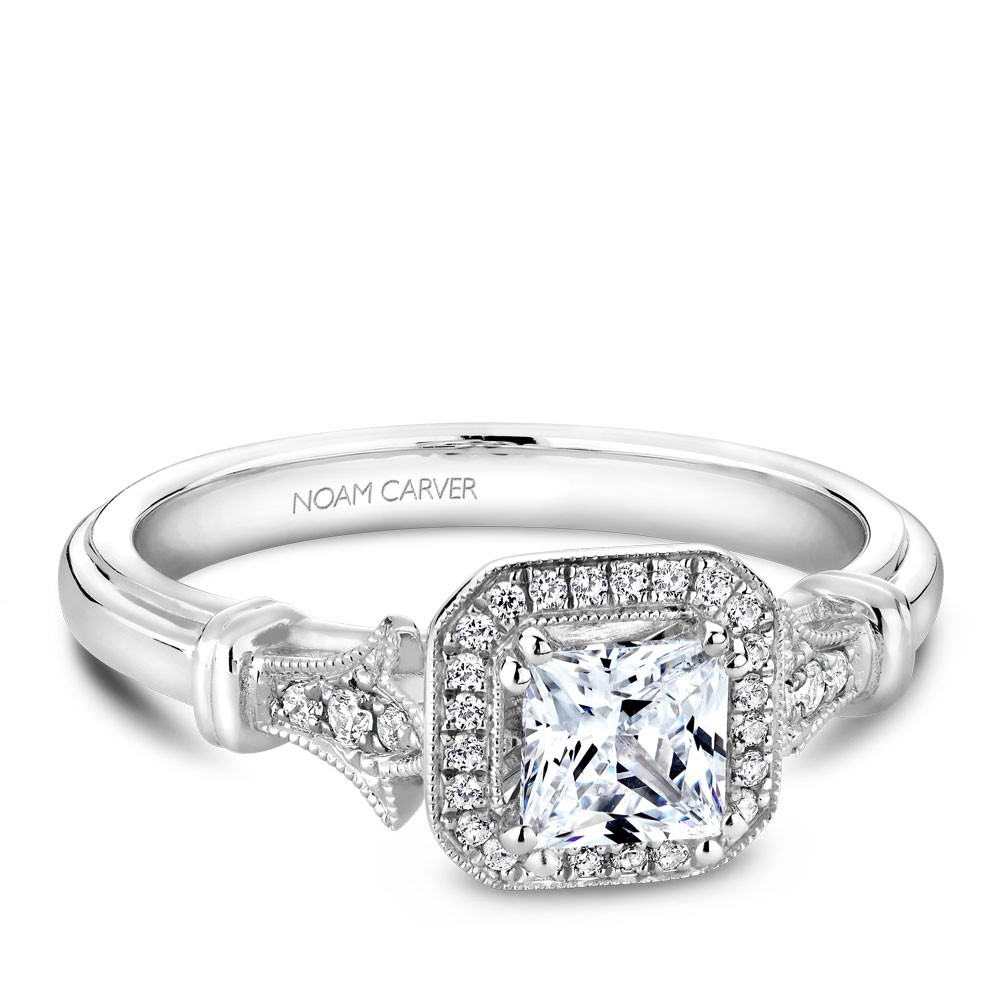 A vintage Carver Studio white gold engagement ring with a princess center stone and 23 diamonds.