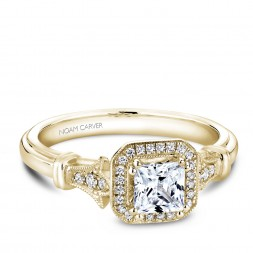 A vintage Carver Studio yellow gold engagement ring with a princess center stone and 23 diamonds.