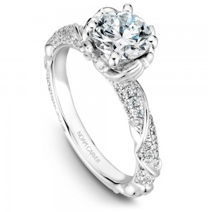 A floral Carver Studio white gold engagement ring with a round center stone and 101 diamonds.