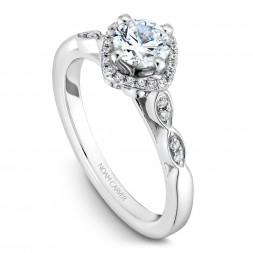 A floral Carver Studio white gold engagement ring with 29 diamonds.
