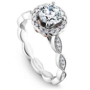 A Carver Studio white gold engagement ring with a floral halo and 35 diamonds.