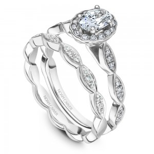 A Carver Studio white gold engagement ring with an oval floral halo and 39 diamonds.