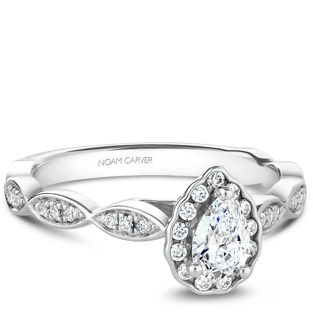 A Carver Studio white gold engagement ring with a pear floral halo and 38 diamonds.