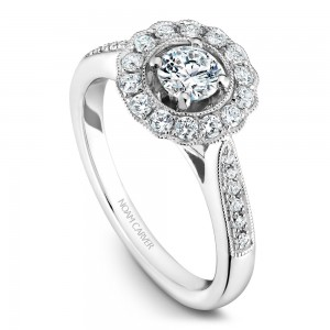 A floral Carver Studio white gold engagement ring with 27 diamonds.