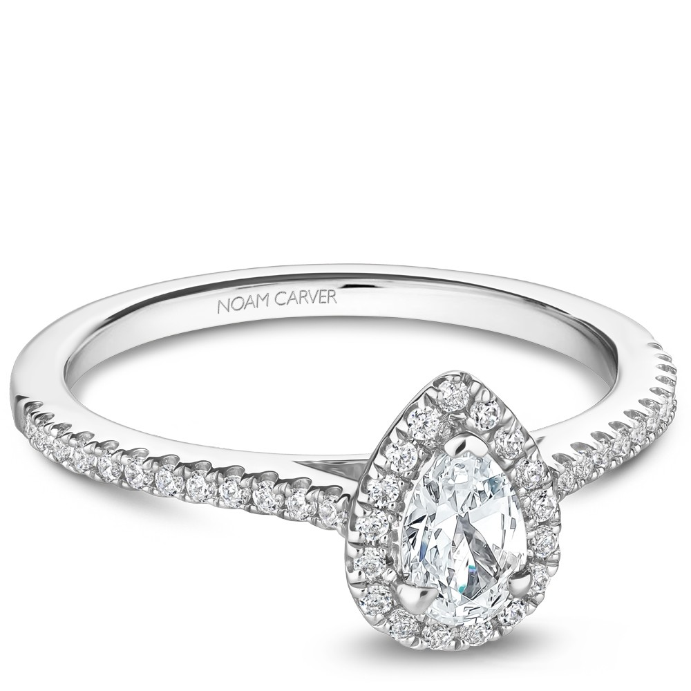 A Carver Studio white gold engagement ring with a pear halo and 45 diamonds.