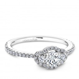 A 3-stone Carver Studio white gold engagement ring with 47 diamonds.