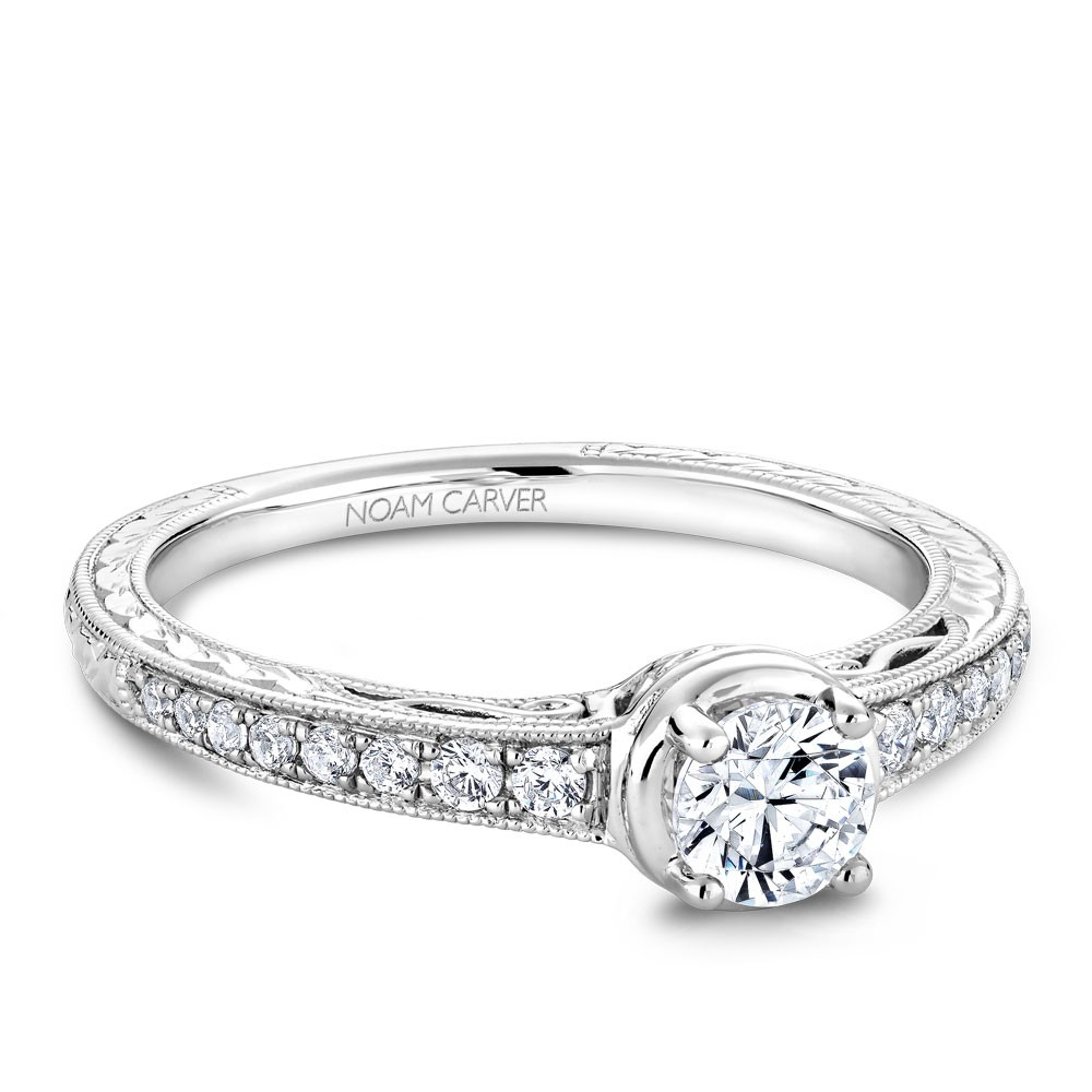 A Carver Studio white gold engagement ring with 17 diamonds.