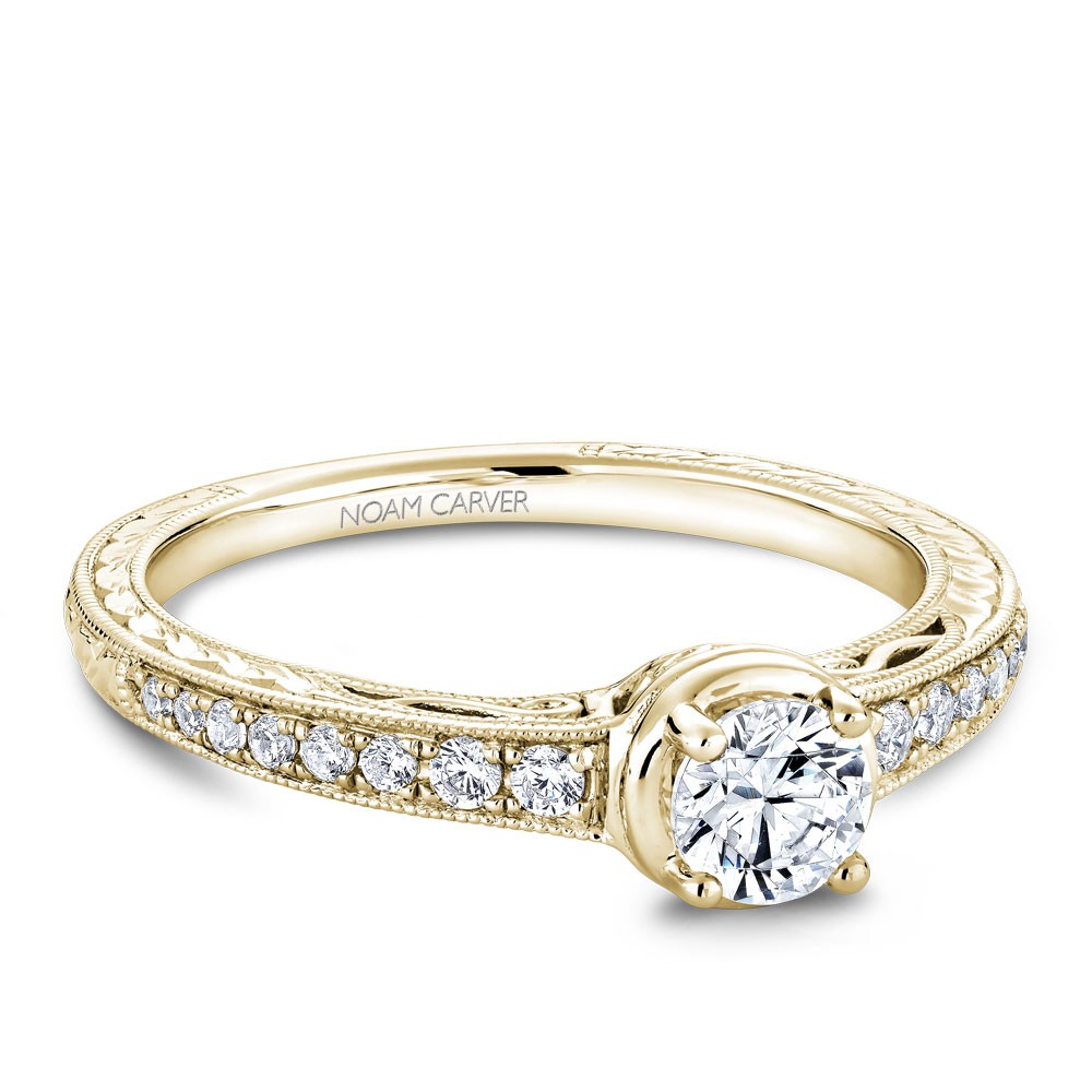 A Carver Studio yellow gold engagement ring with 17 diamonds.