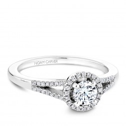 A Carver Studio white gold engagement ring with a split band, a halo and 59 diamonds.