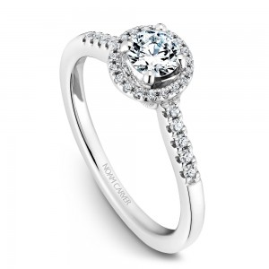 A Carver Studio white gold engagement ring with an oval halo and 44 diamonds.
