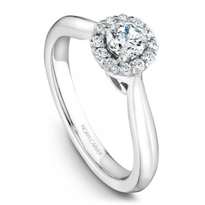 A floral Carver Studio white gold engagement ring with a halo and 13 diamonds.