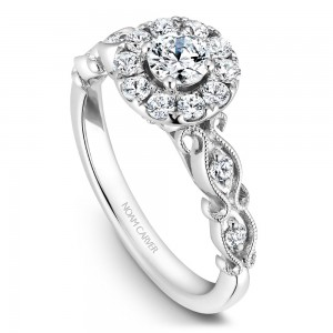 A floral Carver Studio white gold engagement ring with a halo and 17 diamonds.