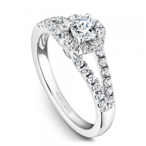 A Carver Studio white gold engagement ring with an oval halo and 39 diamonds.