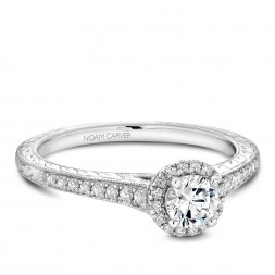 A vintage Carver Studio white gold engagement ring with a halo and 33 diamonds.