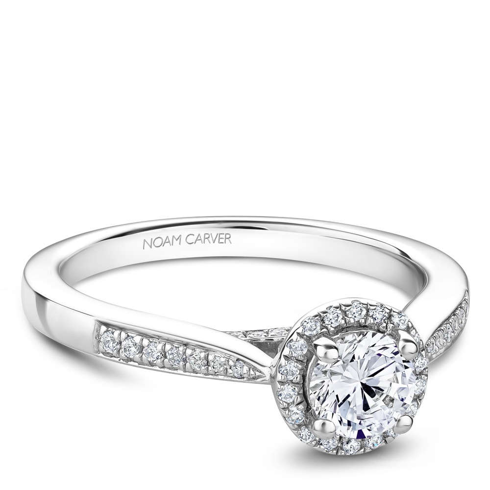 A floral Carver Studio white gold engagement ring with 45 diamonds.
