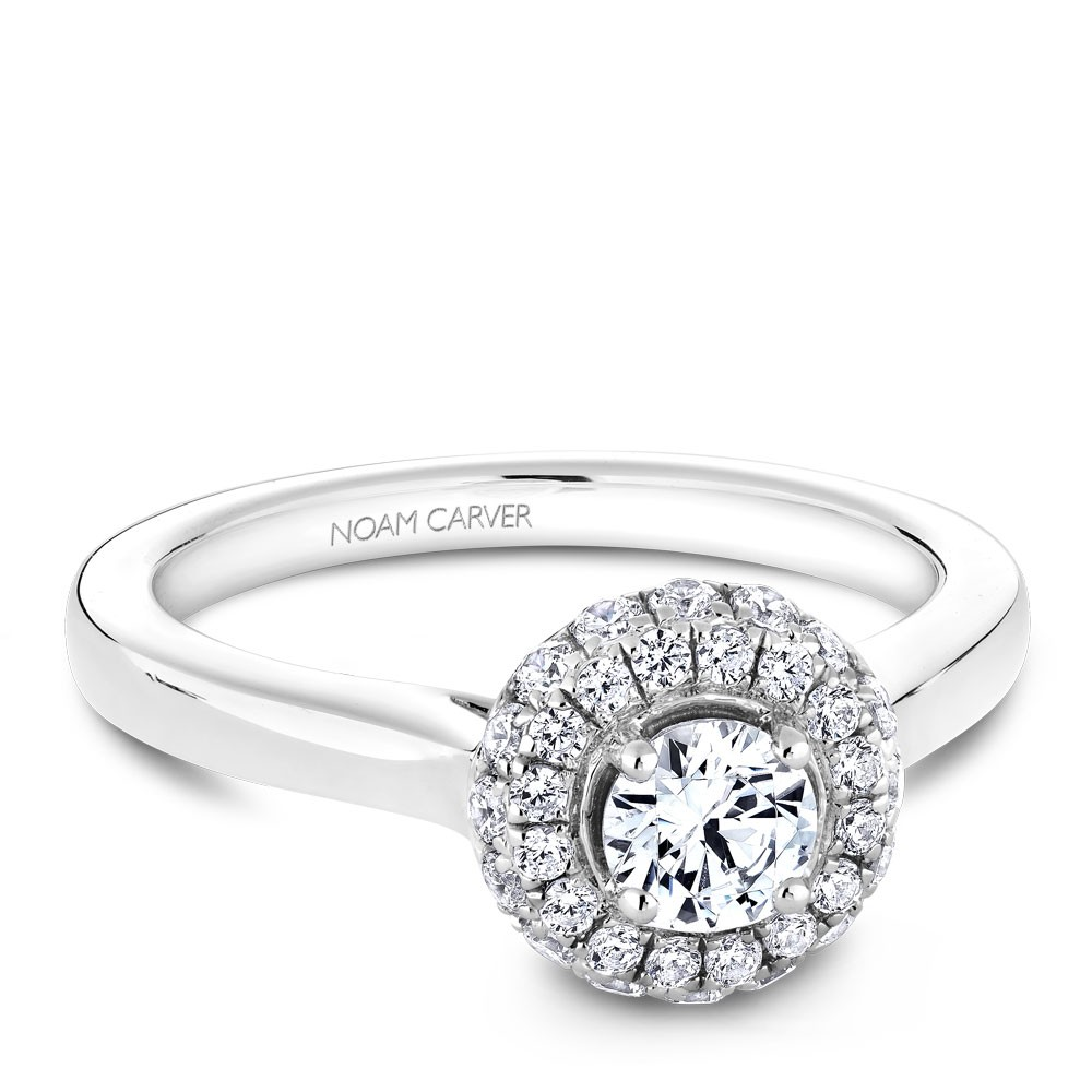 A floral Carver Studio white gold engagement ring with 35 diamonds.