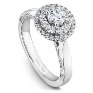 A floral Carver Studio white gold engagement ring with 47 diamonds.