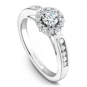 A vintage Carver Studio white gold engagement ring with 25 diamonds.