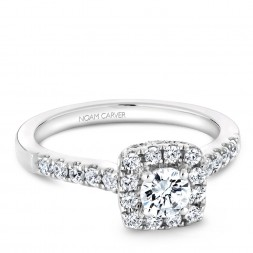 A Carver Studio white gold engagement ring with a square halo and 33 diamonds.