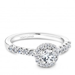 A Carver Studio white gold engagement ring with a halo and 23 diamonds.