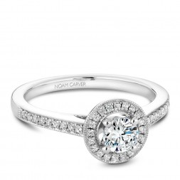 A Carver Studio white gold engagement ring with a halo and 39 diamonds.