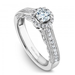 A vintage Carver Studio white gold engagement ring with 61 diamonds.
