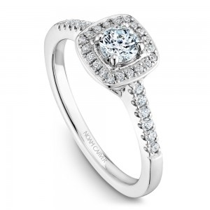 A Carver Studio white gold engagement ring with a cushion halo and 33 diamonds.