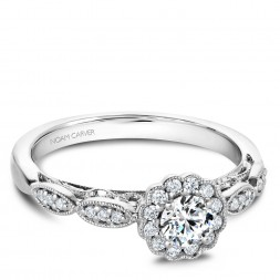 A floral Carver Studio white gold engagement ring with 25 diamonds.